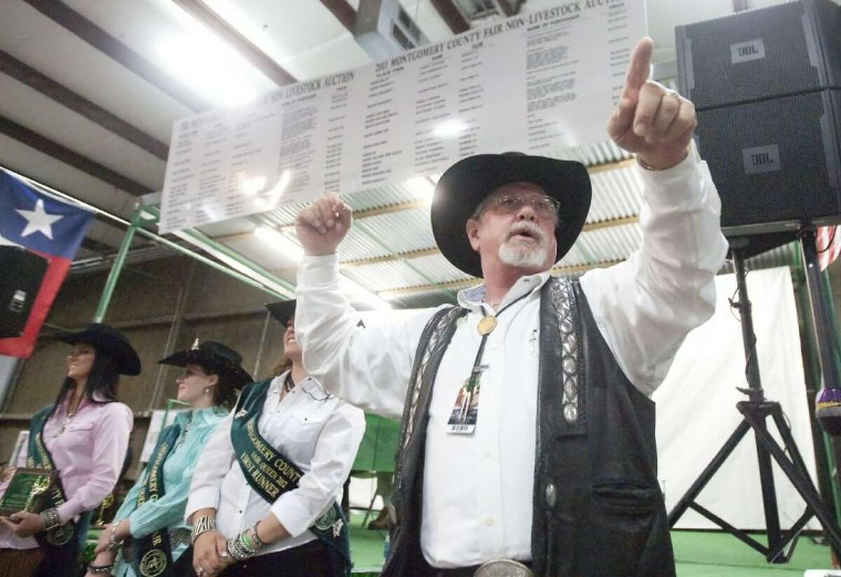 Michael Stewart looks for bids during the junior non-livestock auction Monday at the Montgomery County Fairgrounds.