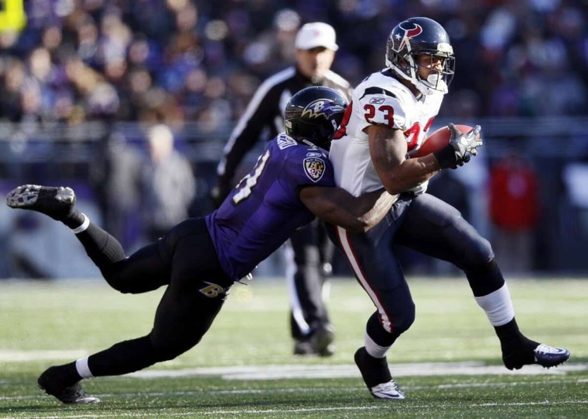 Baltimore Ravens strong safety Bernard Pollard, left, stops Houston Texans running back Arian Foster during the first half in Baltimore, Sunday.
