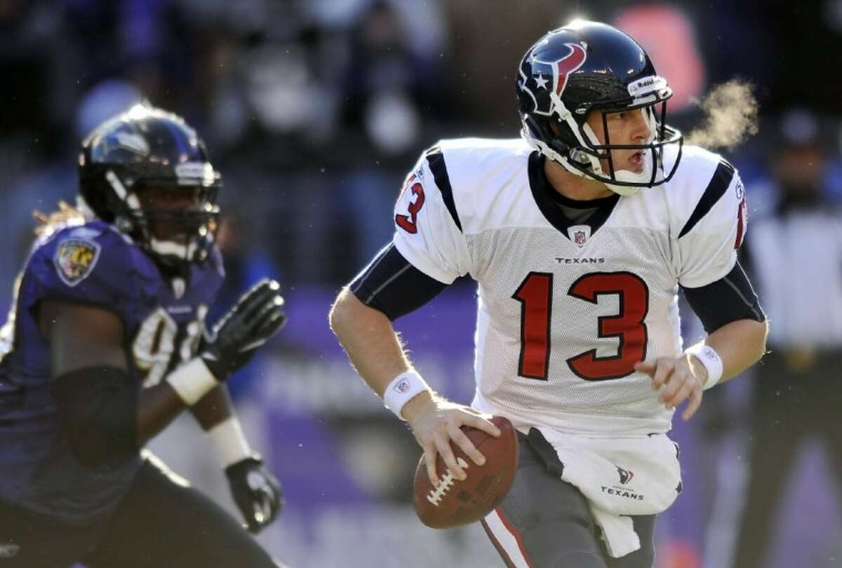 Houston Texans quarterback T.J. Yates scrambles with the ball during the first half of an NFL divisional playoff football game against the Baltimore Ravens in Baltimore, Sunday.