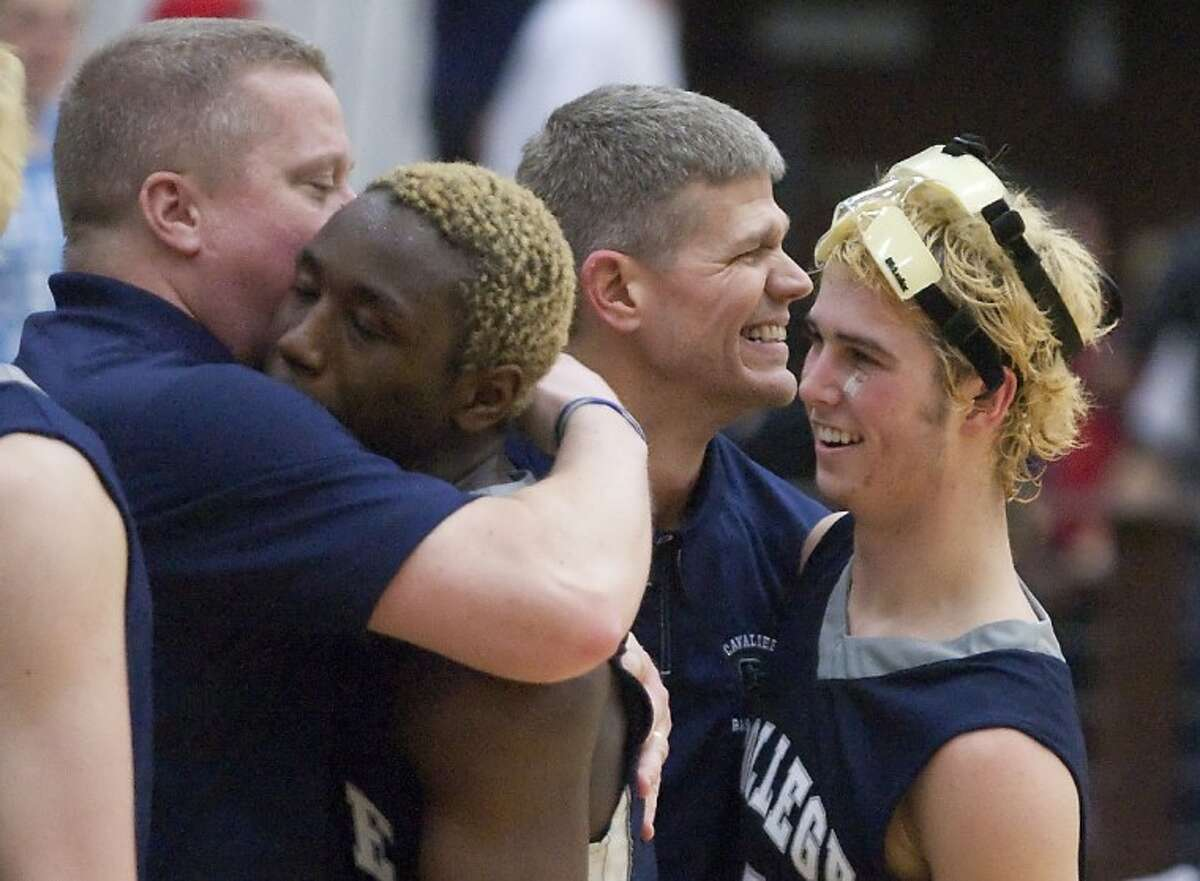 College Park coaches celebrate with players after their victory against Kingwood Tuesday at Porter High School. See more photos online at www.yourhoustonnews.mycapture.com.