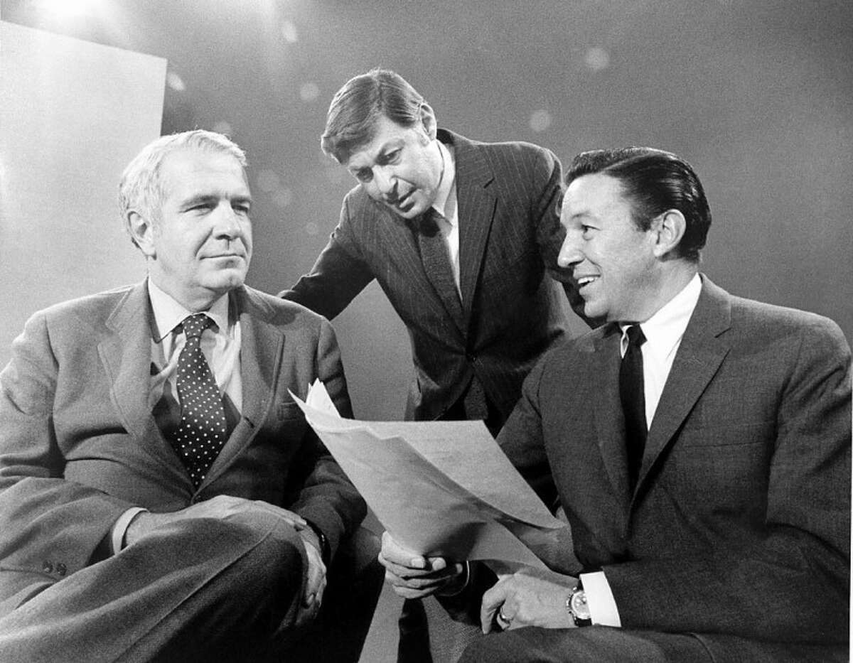 """This 1968 photo released by CBS shows """"60 Minutes"""" correspondents Harry Reasoner, left, and Mike Wallace, right, with creator and producer Don Hewitt on the set in New York. Wallace, famed for his tough interviews on """"60 Minutes,"""" died, Saturday, April 7. He was 93."""
