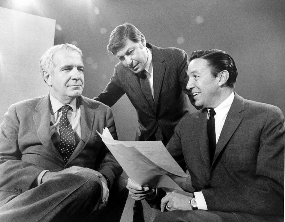 "This 1968 photo released by CBS shows ""60 Minutes"" correspondents Harry Reasoner, left, and Mike Wallace, right, with creator and producer Don Hewitt on the set in New York. Wallace, famed for his tough interviews on ""60 Minutes,"" died, Saturday, April 7. He was 93. Photo: Anonymous"