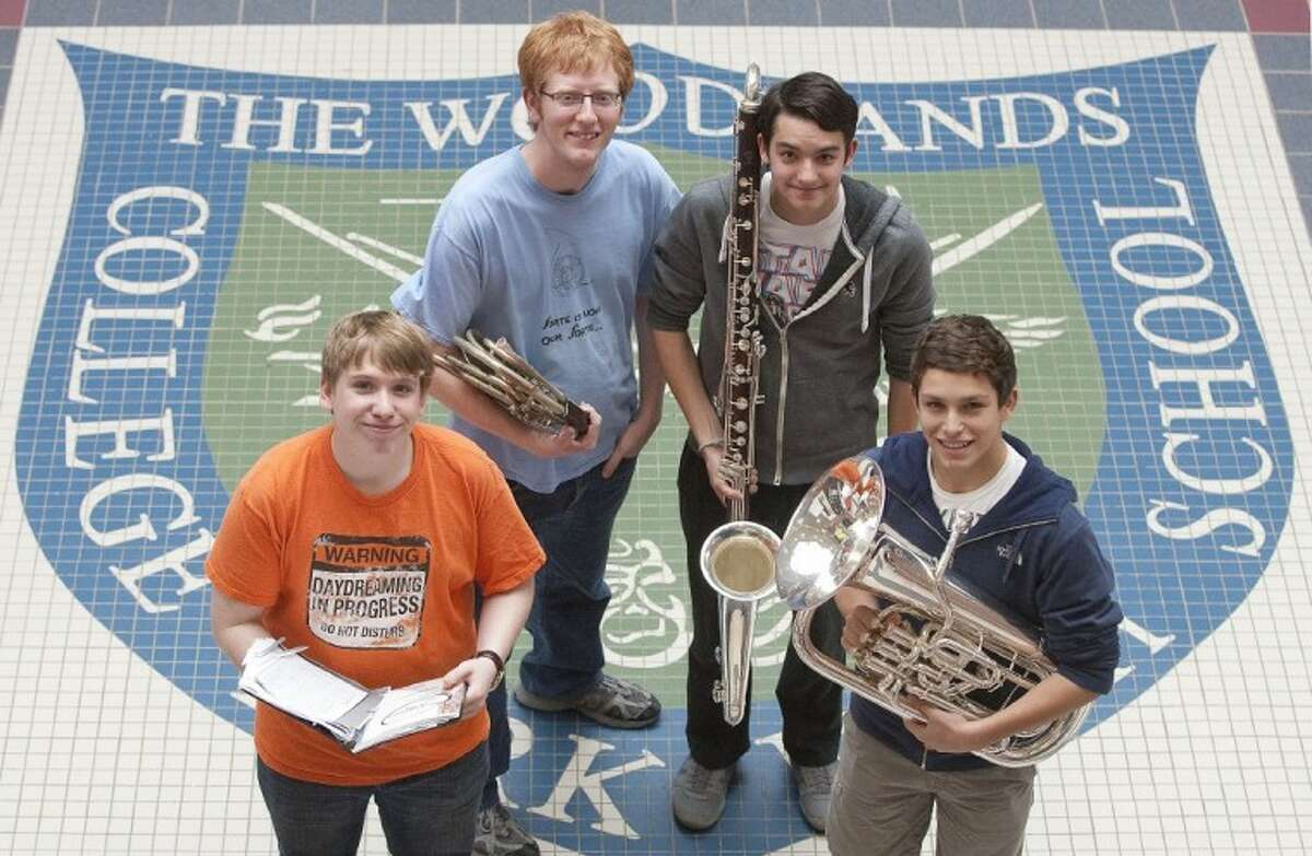 Woodlands College Park High School freshman Austin Rabon, from left, senior Kendrick Choate, senior Sean Smith and junior Steven Houston made the All-State Band and Choir. Rabon is a Tenor 1 in the All-State Mixed Choir. Choate, on French horn, Smith, on Contra-bass, and Houston, on euphonium, will audition Wednesday for their rankings in the All-State Band or Orchestra.