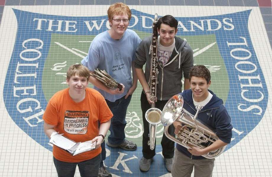 Woodlands College Park High School freshman Austin Rabon, from left, senior Kendrick Choate, senior Sean Smith and junior Steven Houston made the All-State Band and Choir. Rabon is a Tenor 1 in the All-State Mixed Choir. Choate, on French horn, Smith, on Contra-bass, and Houston, on euphonium, will audition Wednesday for their rankings in the All-State Band or Orchestra. Photo: Karl Anderson