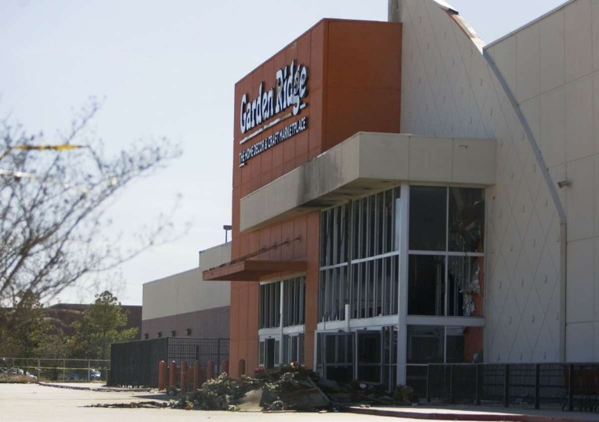 Fire damage is visible on the exterior of the Garden Ridge building in Conroe.