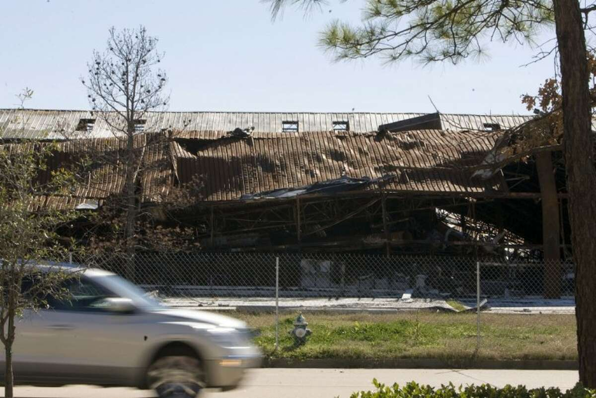 A collapsed wall is seen at the Garden Ridge store in the College Park Shopping Center.