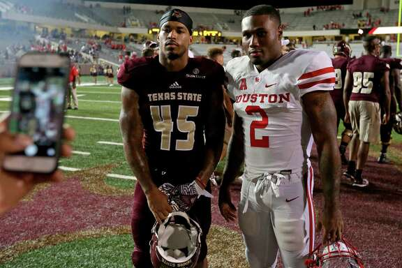 Texas State Bobcats running back Jericho Worrell and Houston Cougars running back Duke Catalon pose for photos after the game Saturday Sept. 24, 2016 at Bobcat Stadium in San Marcos, Tx. The Houston Cougars won 64-3.
