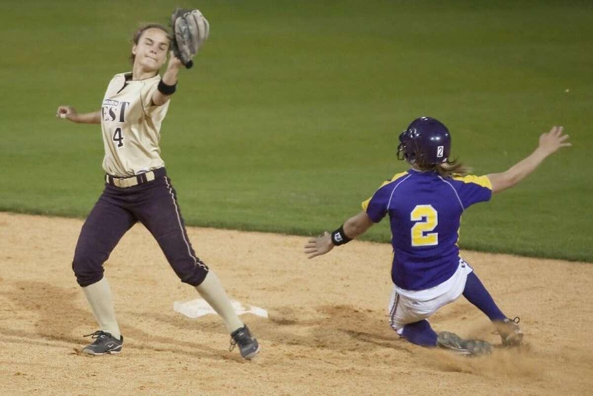 Montgomery's Malloree Schur beats Magnolia West's Kayci Moore to second base Monday at Montgomery High School.