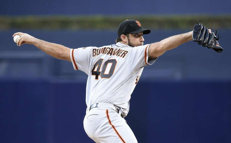SAN DIEGO, CALIFORNIA - SEPTEMBER 24:  Madison Bumgarner #40 of the San Francisco Giants pitches during the first inning of a baseball game against the San Diego Padres at PETCO Park on September 24, 2016 in San Diego, California.  (Photo by Denis Poroy/Getty Images) Photo: Denis Poroy, Getty Images