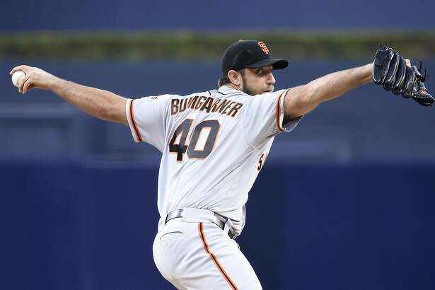 SAN DIEGO, CALIFORNIA - SEPTEMBER 24:  Madison Bumgarner #40 of the San Francisco Giants pitches during the first inning of a baseball game against the San Diego Padres at PETCO Park on September 24, 2016 in San Diego, California.  (Photo by Denis Poroy/Getty Images)