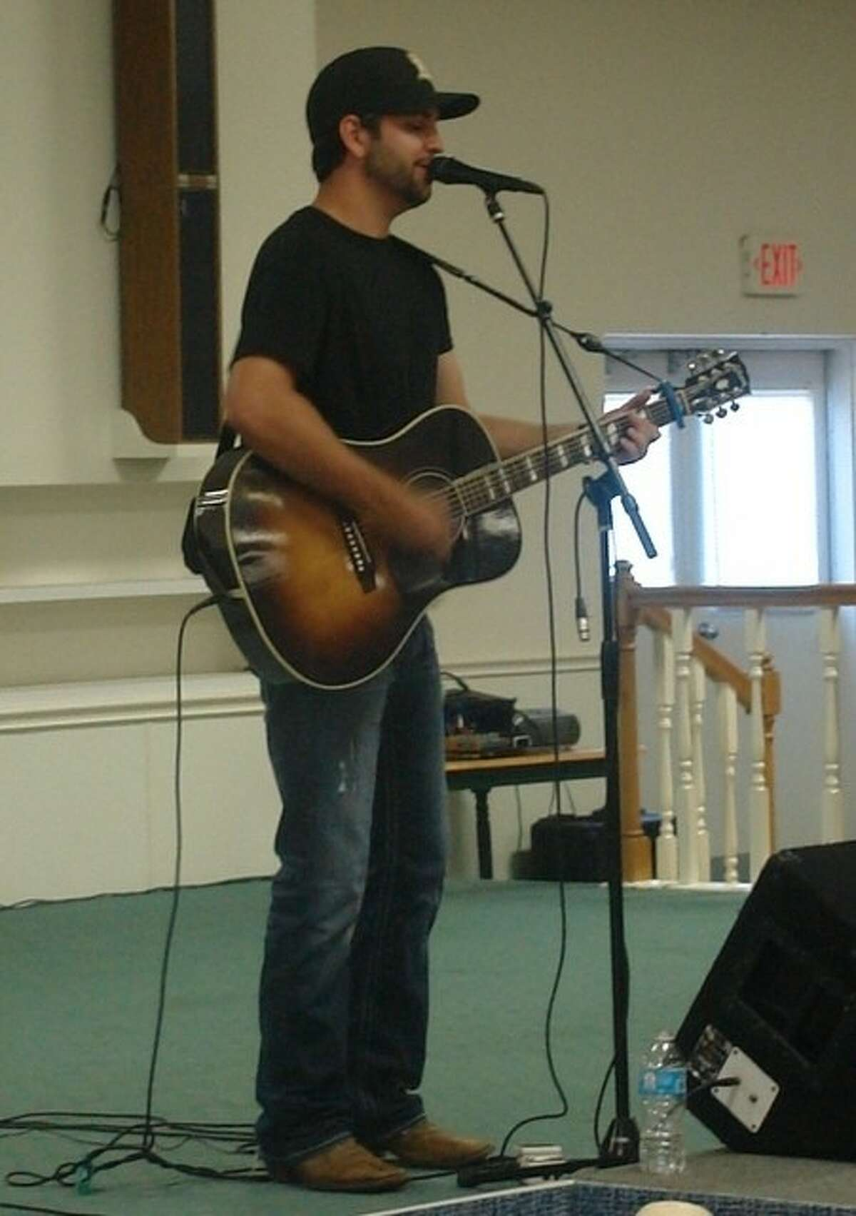 Clayton Gardner, a country singer and songwriter from College Station, performs in front of an audience at the Lake Conroe Event Center Thursday night as part of the Experience Montgomery Showcase.