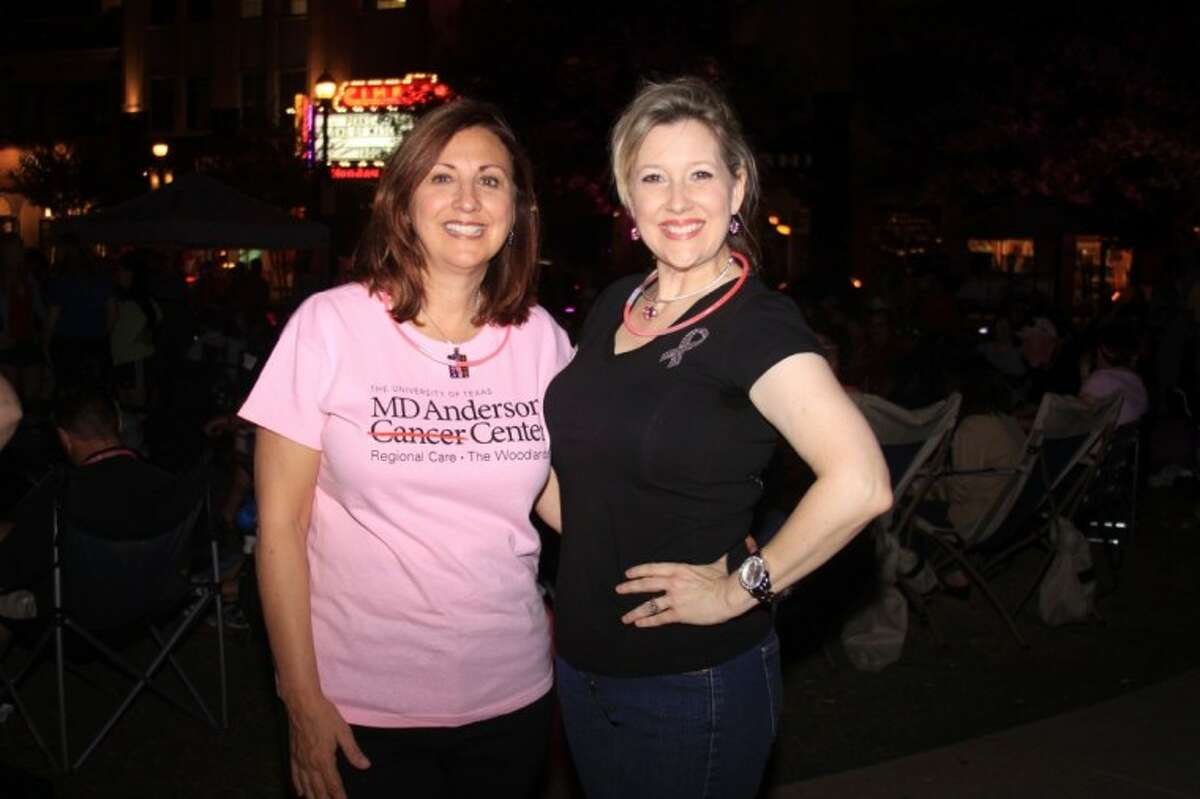 Dr. Pamela Schlembach, with MD Anderson Regional Care Center The Woodlands, takes time to visit patient Coleen Ingram during the Pink Lighting event at Market Street Thursday night.