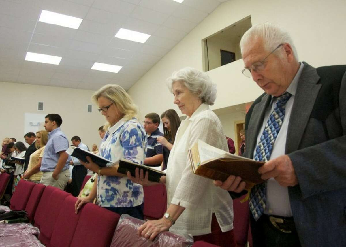 Members of the Bible Baptist Church take part in a celebration service Saturday during the grand opening of the church's new buildig at 10984 FM 1485 at Waukeegan.