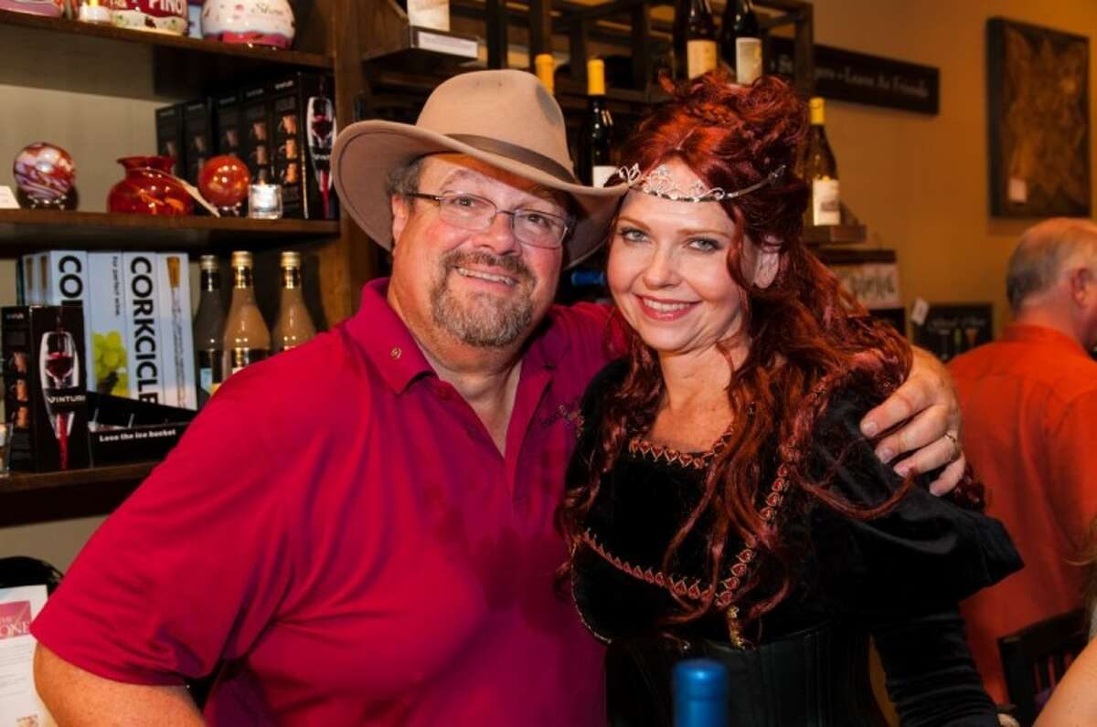Rhonda Redmon, co-owner of GenuWine Wine Bar in Magnolia with Barb Salinas, is dressed in her Renaissance Finery in celebration of the wine event held on June 6 at GenuWine during Wine and Food Week in The Woodlands. Next to this Renaissance Queen is Courier Wine Columnist, Ron Saikowski. Queen Rhonda enjoyed this event with the characters from the Texas Renaissance Festival along with the multitude of women at this event that she has already scheduled it for next year's Wine and Food Week in The Woodlands.s