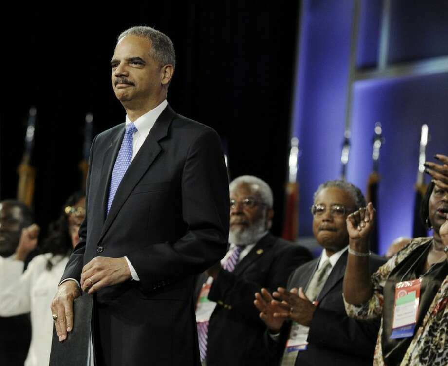 HOLDER Photo: Pat Sullivan