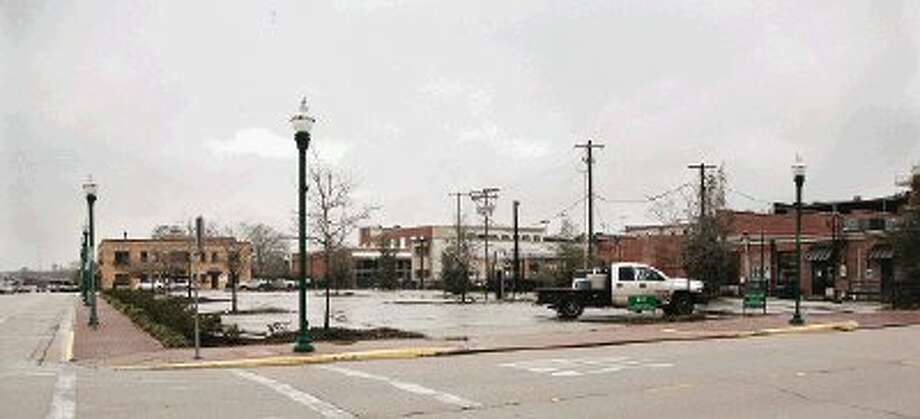 The city of Conroe parking lot, located at the intersection of Metcalf and Main streets, is lacking many paid customers this week.
