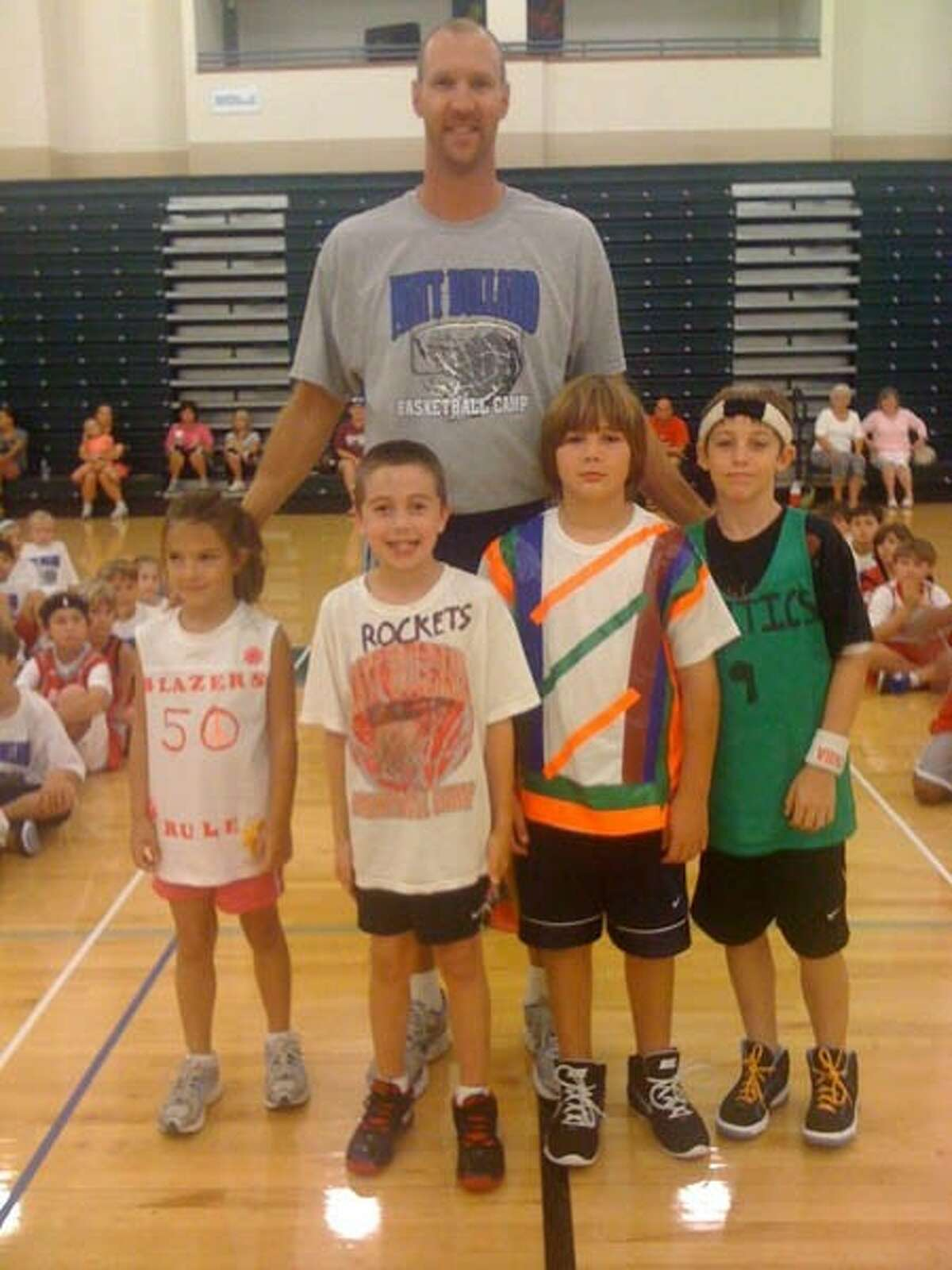Former Houston Rockets player Matt Bullard poses with some of his summer basketball camp students. Bullard will host his 19th annual camp Monday through Friday at The John Cooper School in The Woodlands.