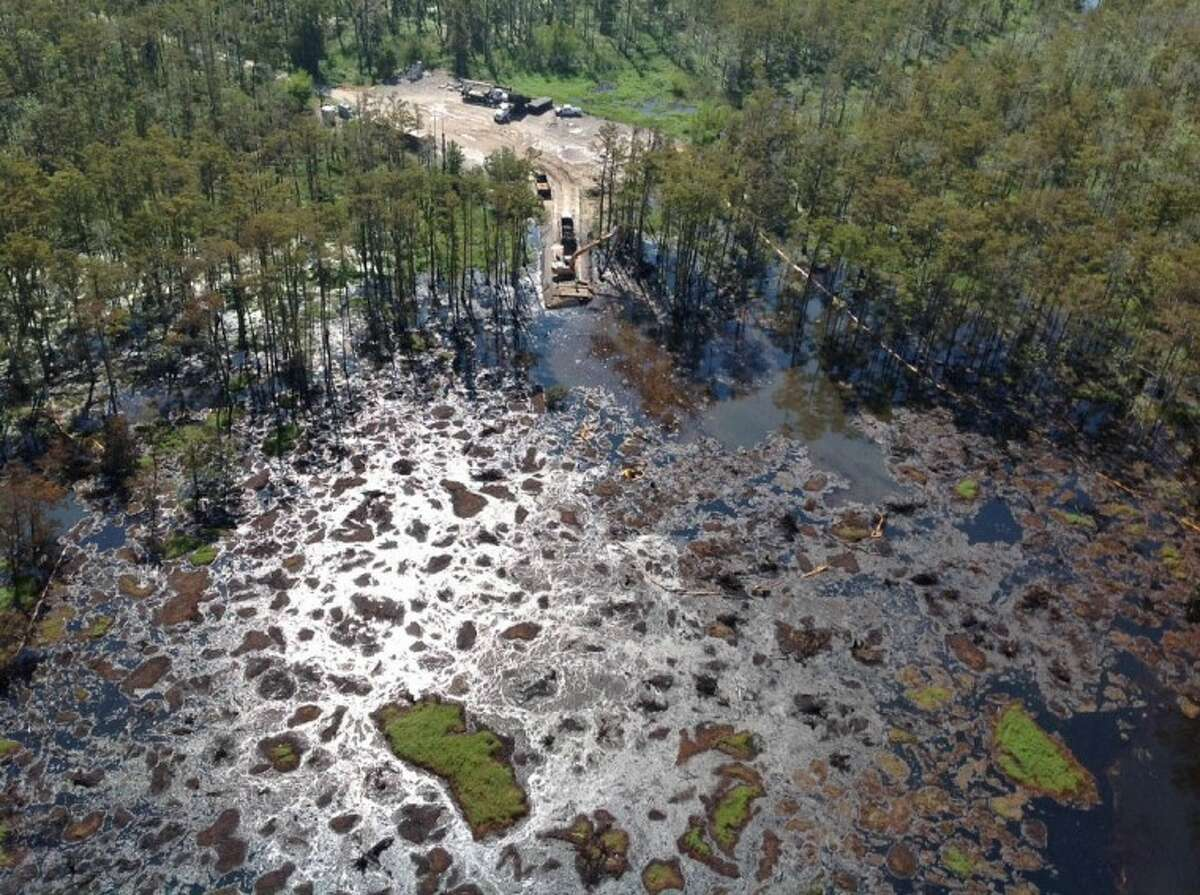 In this undated photo provided by the Louisiana State Police via The Advocate, shallow wells will be drilled in the vicinity of the sinkhole that emerged Aug. 3 in Assumption Parish swamplands in Bayou Corne, La.