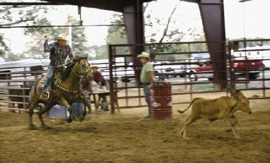 Lone Star Cowboy Church Lead Pastor Randy Weaver and his horse Humo Command practice their tie-down roping skills Tuesday night at the church's arena off Eva Street in Montgomery.