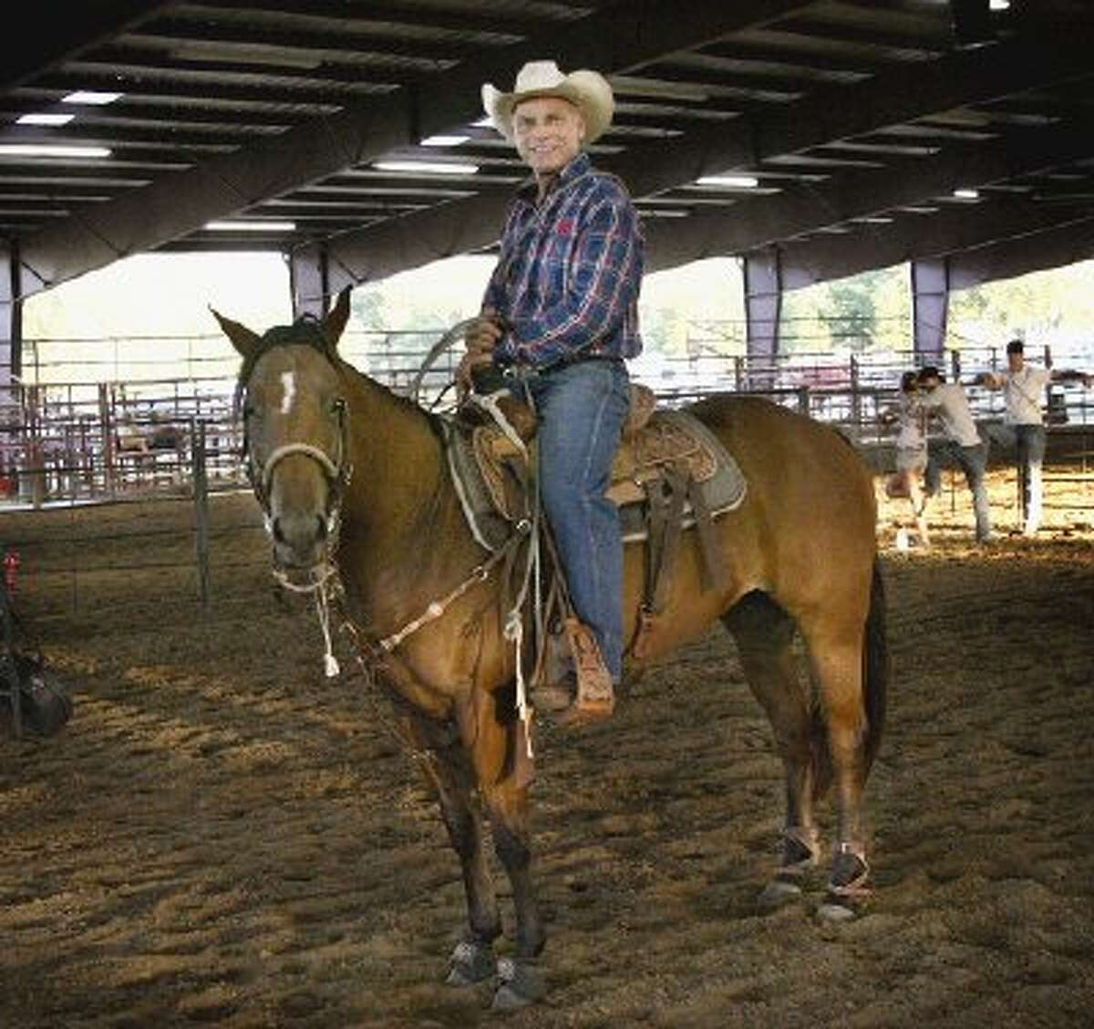 Randy Weaver, lead pastor at Lone Star Cowboy Church, and his 13-year-old sorrel gelding Humo Command take a breather from tie-down roping at the church's arena Tuesday.