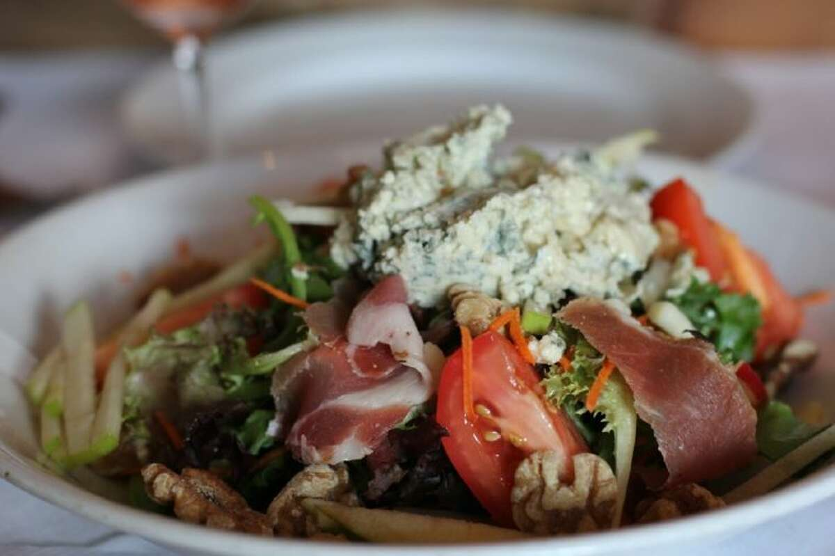Quite wonderful was the giant, fresh, mixed-green salad tossed with juliennes of green apples and crunchy walnut halves and garnished with prosciutto and a giant dollop of creamy gorgonzola - a meal all by itself!