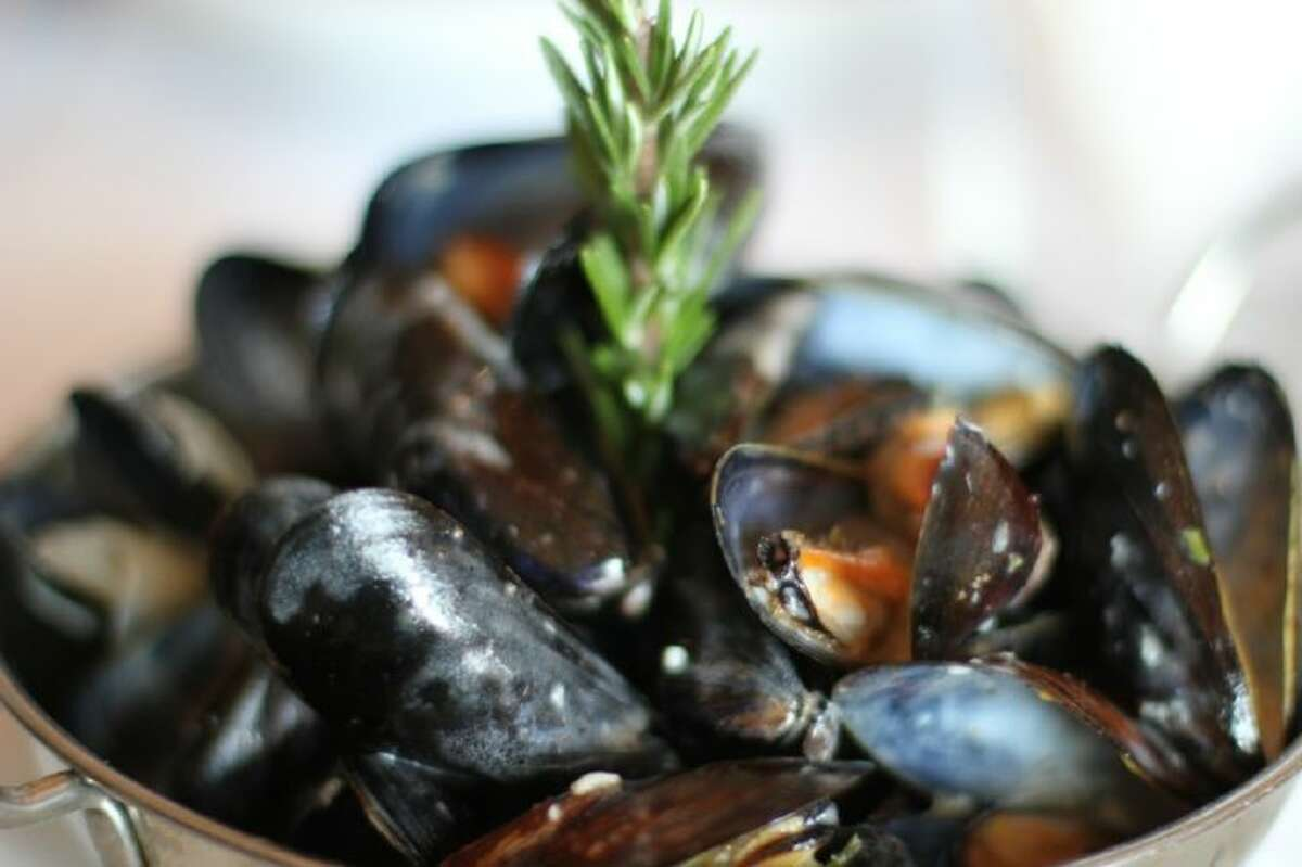 Steamed mussels with fries in a white wine cream sauce at Café Rabelais.