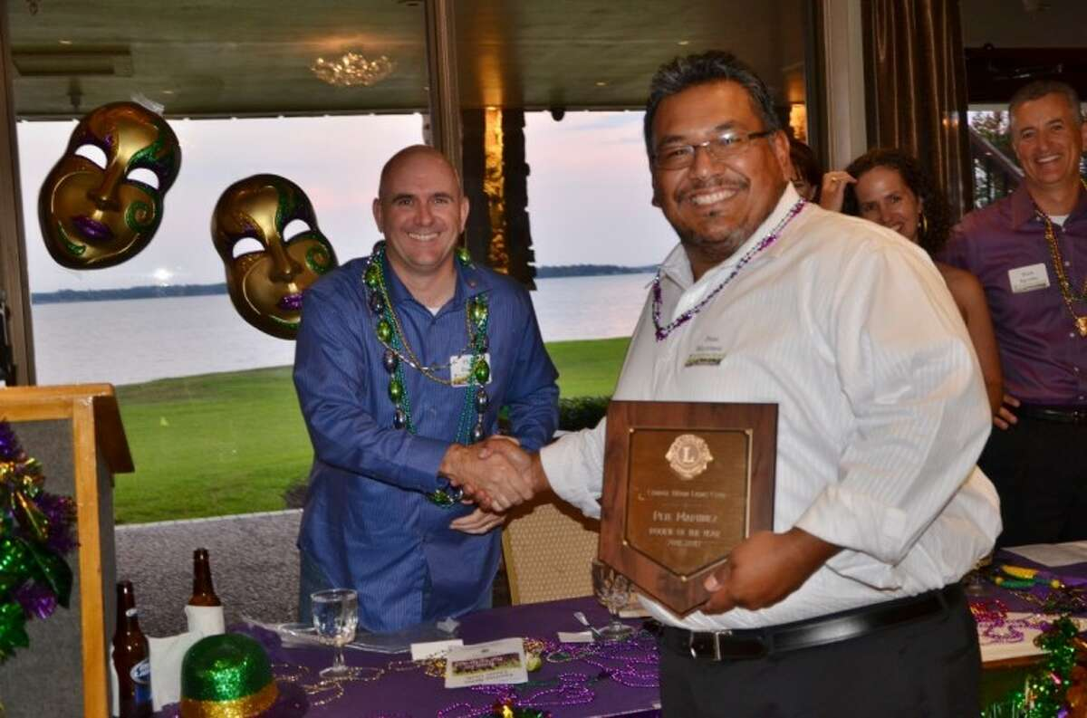 Lion Pete Martinez, right, was named the Conroe Noon Lions Club Rookie of the Year during their 2012 Installation Banquet, presented by club President Philip Dupuis.