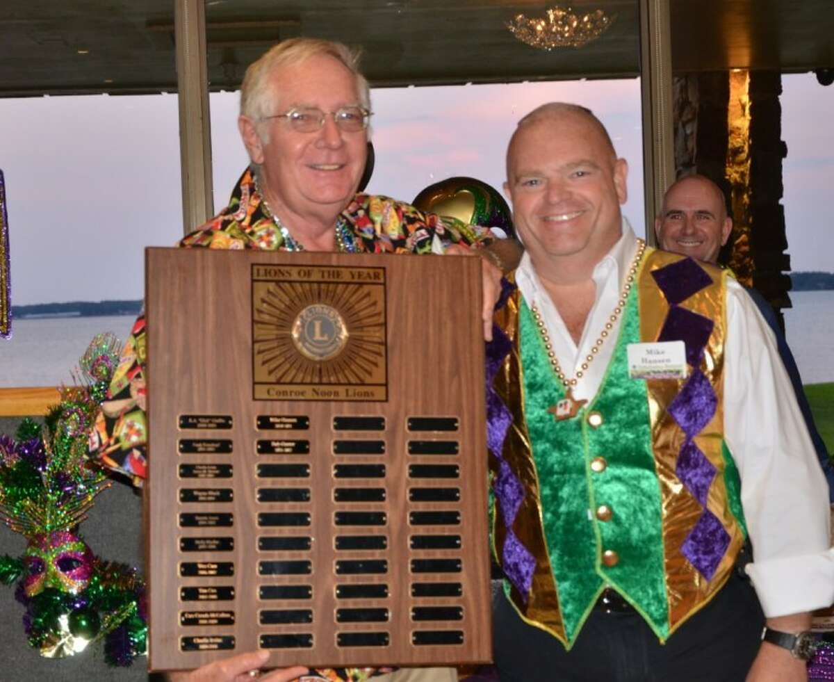 Members of the Conroe Noon Lions Club honored Lion Bob Gunter, left, with the annual Lion of the Year award at the year-end banquet; the presentation was made by last year's Lion of the Year, Mike Hansen.