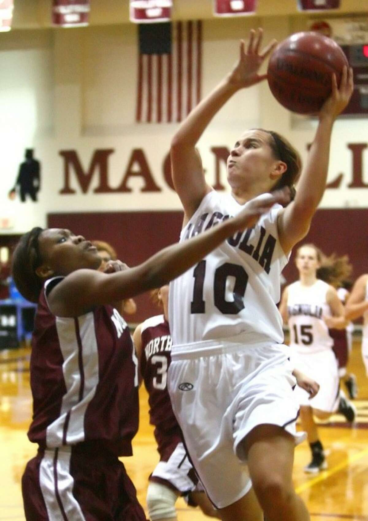 Magnolia's Allison Abendschein shoots over a Northbrook defender. Abendschein was named the All-Montgomery County Co-Offensive Most Valuable Player.