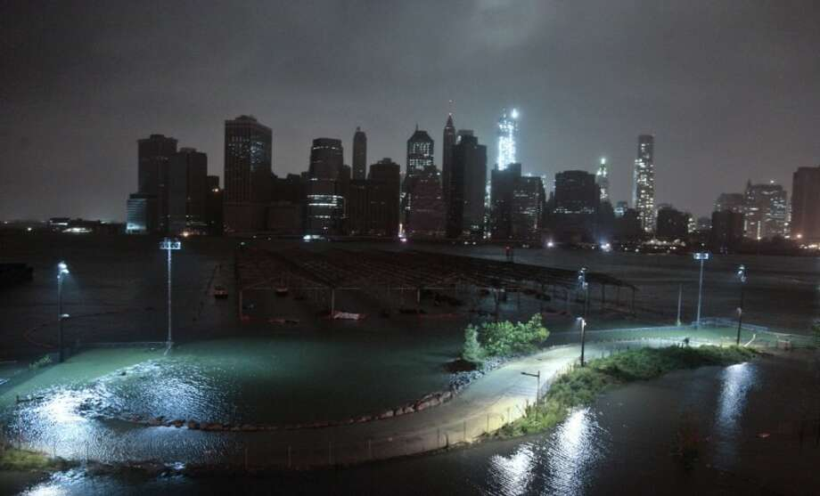 Lower Manhattan goes dark during superstorm Sandy, on Monday, , as seen from the Brooklyn Heights promenade in the Brooklyn borough of New York. Photo: Bebeto Matthews
