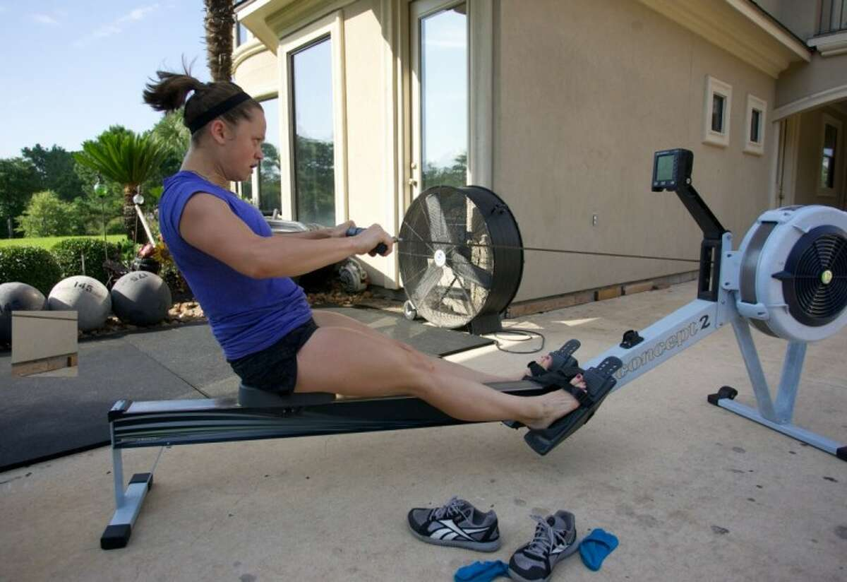 Tayla Correa uses a rowing machine at CrossFit Uproar where she is a trainer.
