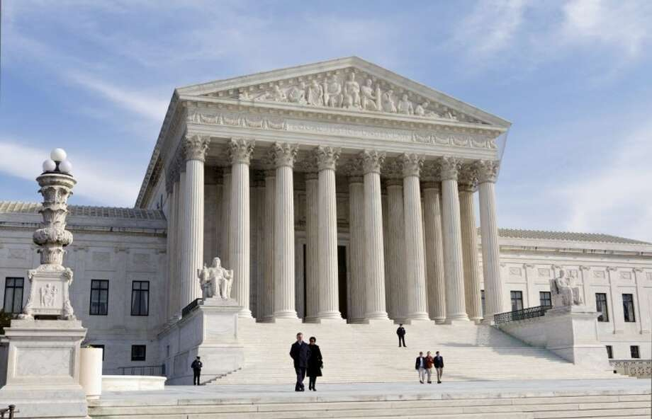 This Jan. 25 file photo shows the U.S. Supreme Court Building in Washington. The problems of high medical costs, widespread waste, and tens of millions of people without insurance will require Congress and the president to keep looking for answers. Photo: J. Scott Applewhite