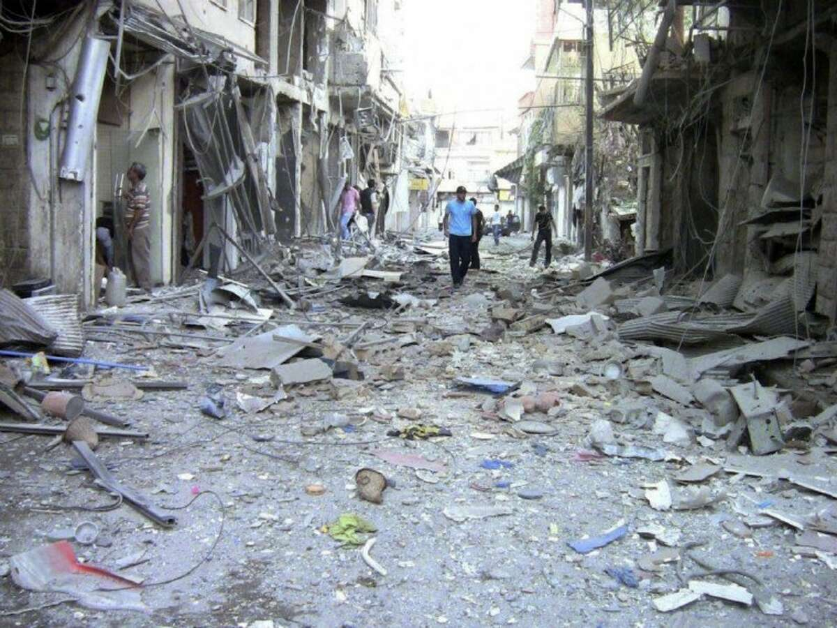 This image made from amateur video released by the Shaam News Network and accessed Saturday purports to show the destruction of houses by shelling from Syrian government forces in Damascus, Syria, Wednesday.