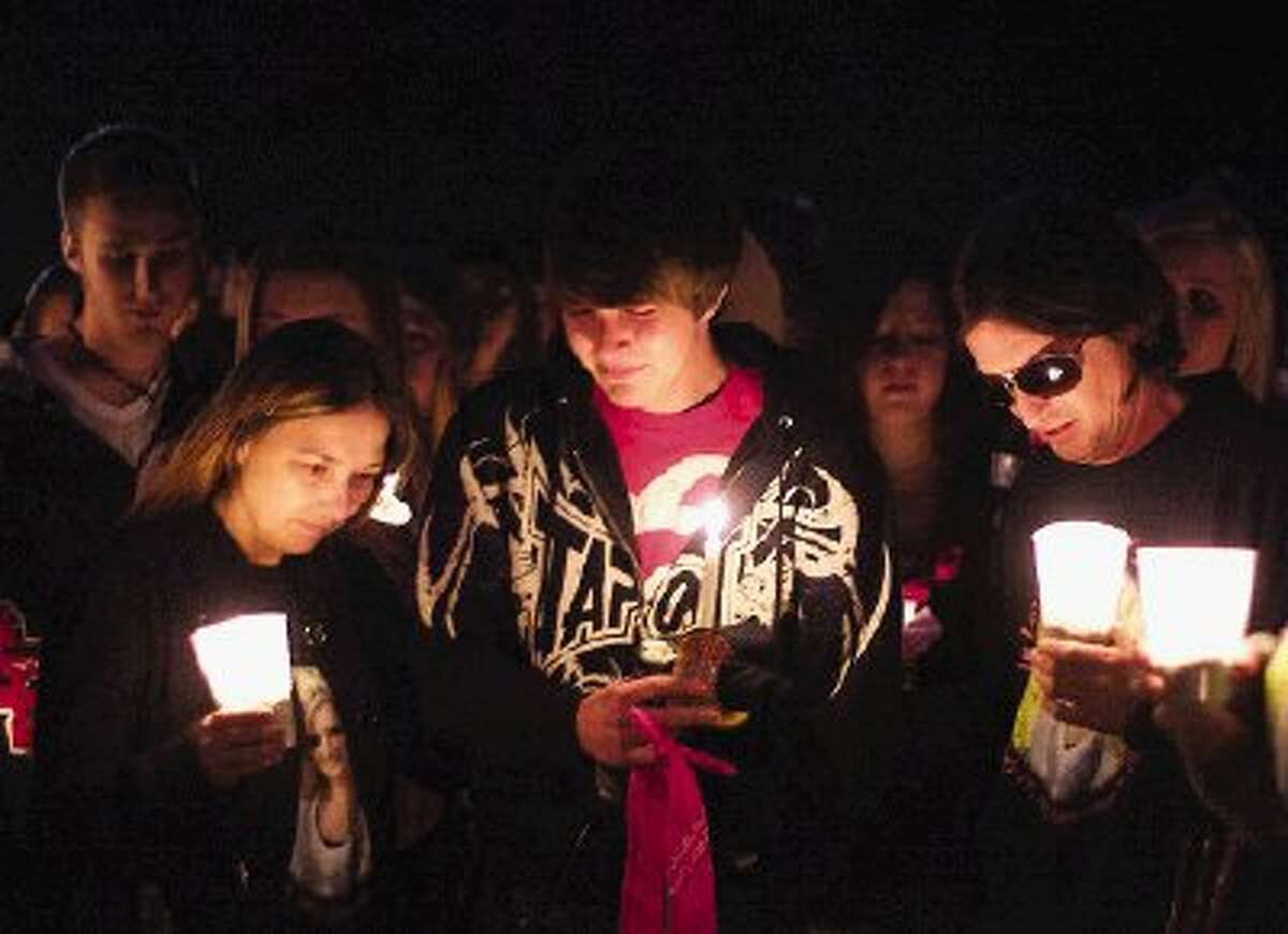 Nick Goodwin, center, boyfriend of Toni Lynn Taylor, participates in the emotional candlelight vigil Tuesday night.