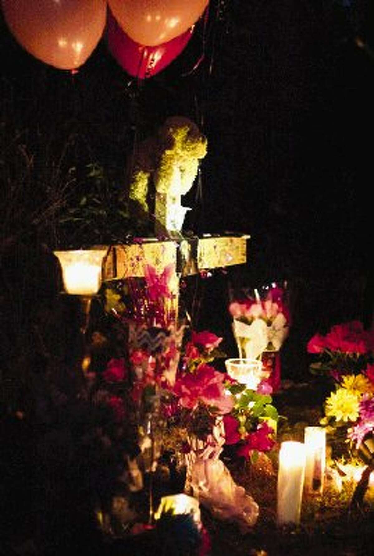 A cross is seen in remembrance of Toni Lynn, Taylor, 19, near the intersection of FM 1484 and Cedar Lane Road.