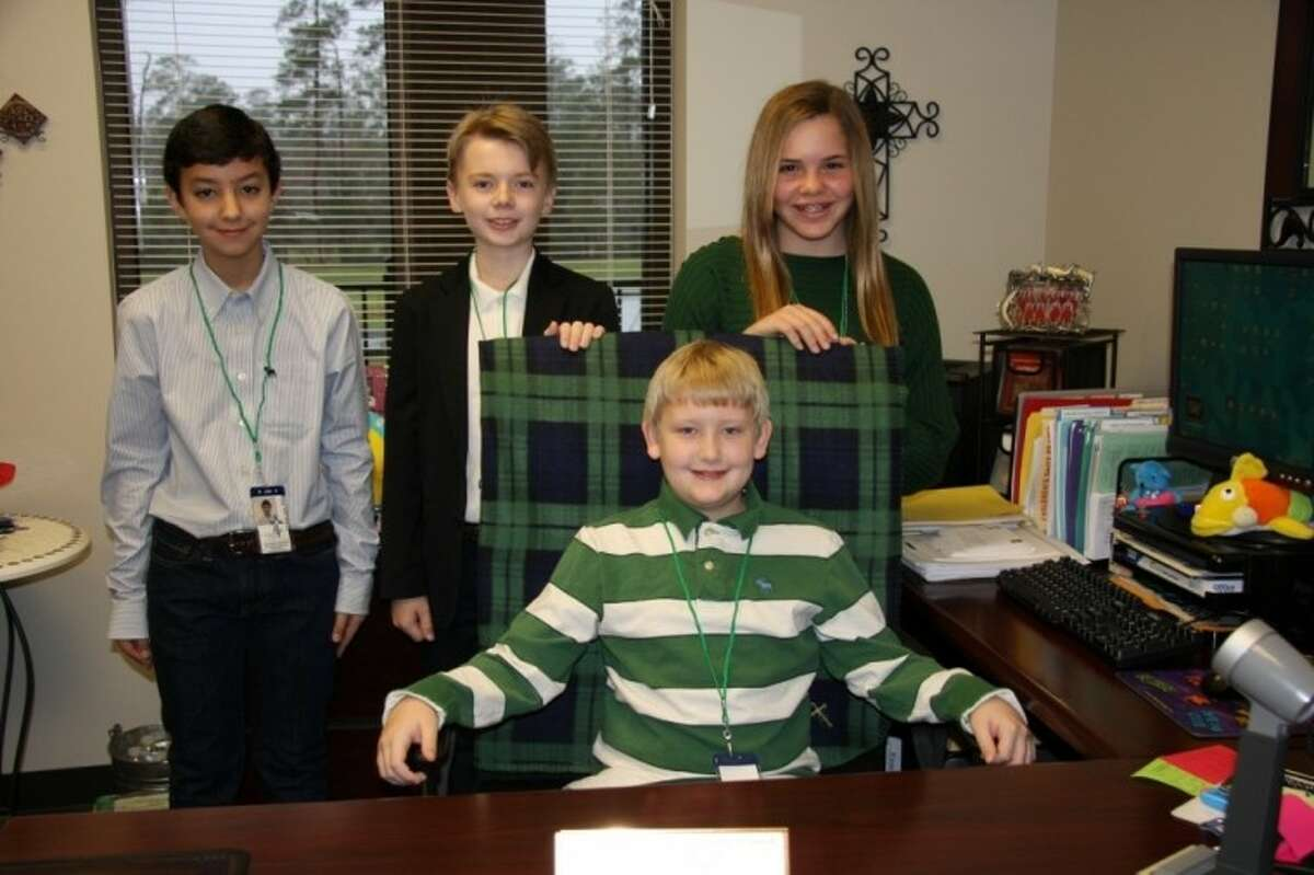 Conor Greene, seated, took over Tuesday as Principal of the Day at St. Anthony of Padua Catholic School, as is school tradition every year during Catholic Schools Week. As his staff, Greene selected Francisco Romero, from left, as the early childhood assistant principal of the day, Kyle Dunn as the middle school assistant principal of the day and Natalia Shrewsbury as the advancement coordinator for the day.