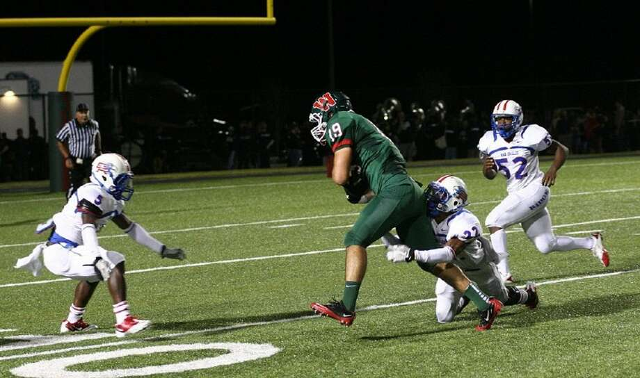 As a wide receiver last fall, The Woodlands' Jayme Taylor helped the Highlanders reach the UIL Class 5A Division I state quarterfinals. During 7 on 7, he has shared time at quarterback with Blaine Gillespie, helping The Woodlands reach the state tournament.