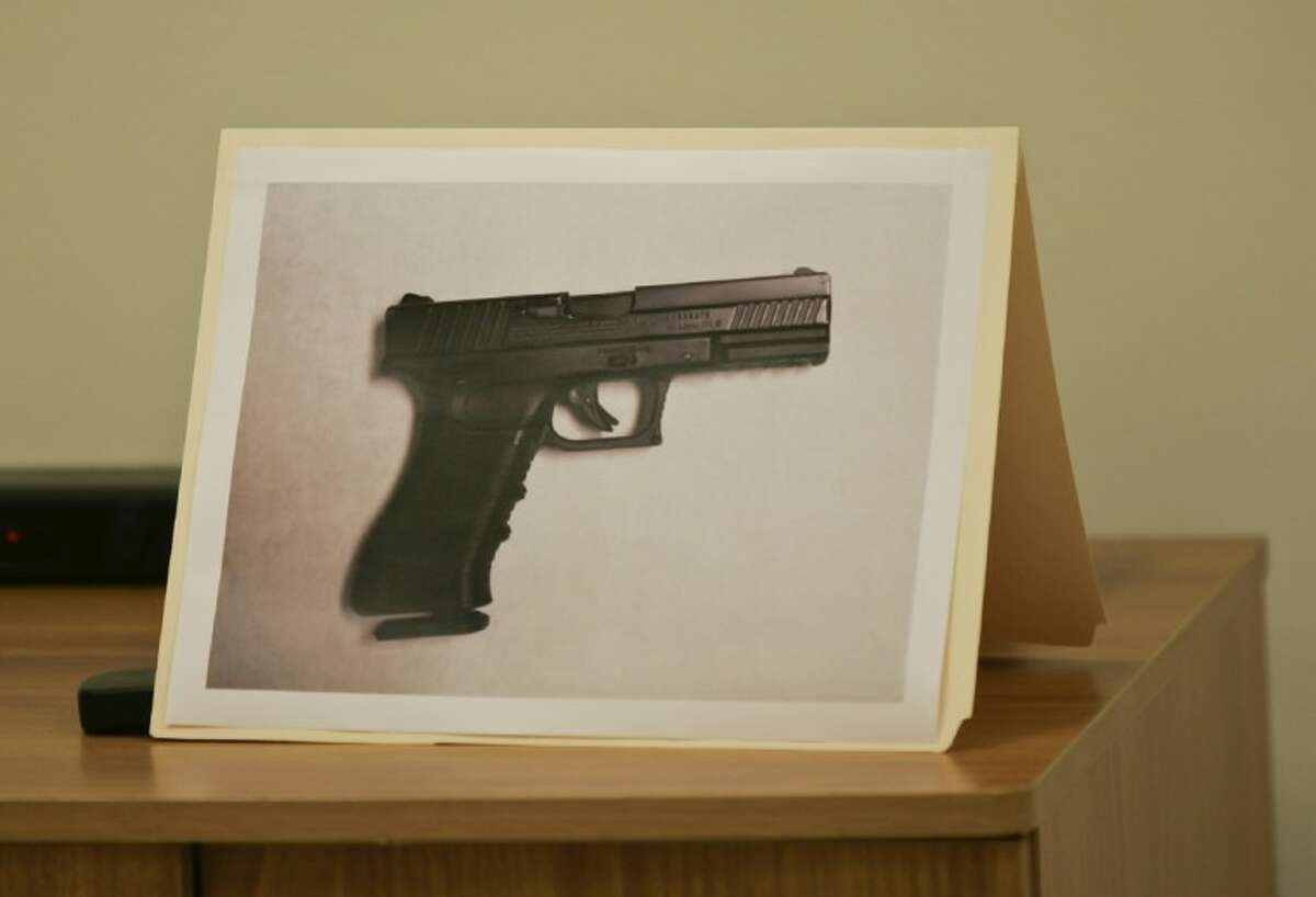 A photo of the carbon dioxide powered pellet handgun 15-year-old Jaime Gonzalez was holding at the time he was shot by police at Cummings Middle School is shown during a news conference.