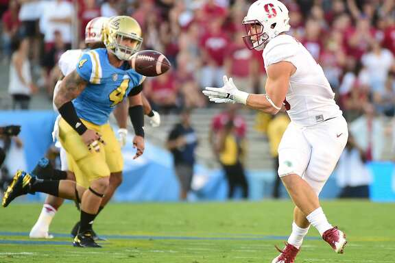 PASADENA, CA - SEPTEMBER 24:  Christian McCaffrey #5 of the Stanford Cardinal makes a catch for a first down in front of Cameron Judge #4 of the UCLA Bruins during the first quarter at Rose Bowl on September 24, 2016 in Pasadena, California.  (Photo by Harry How/Getty Images)