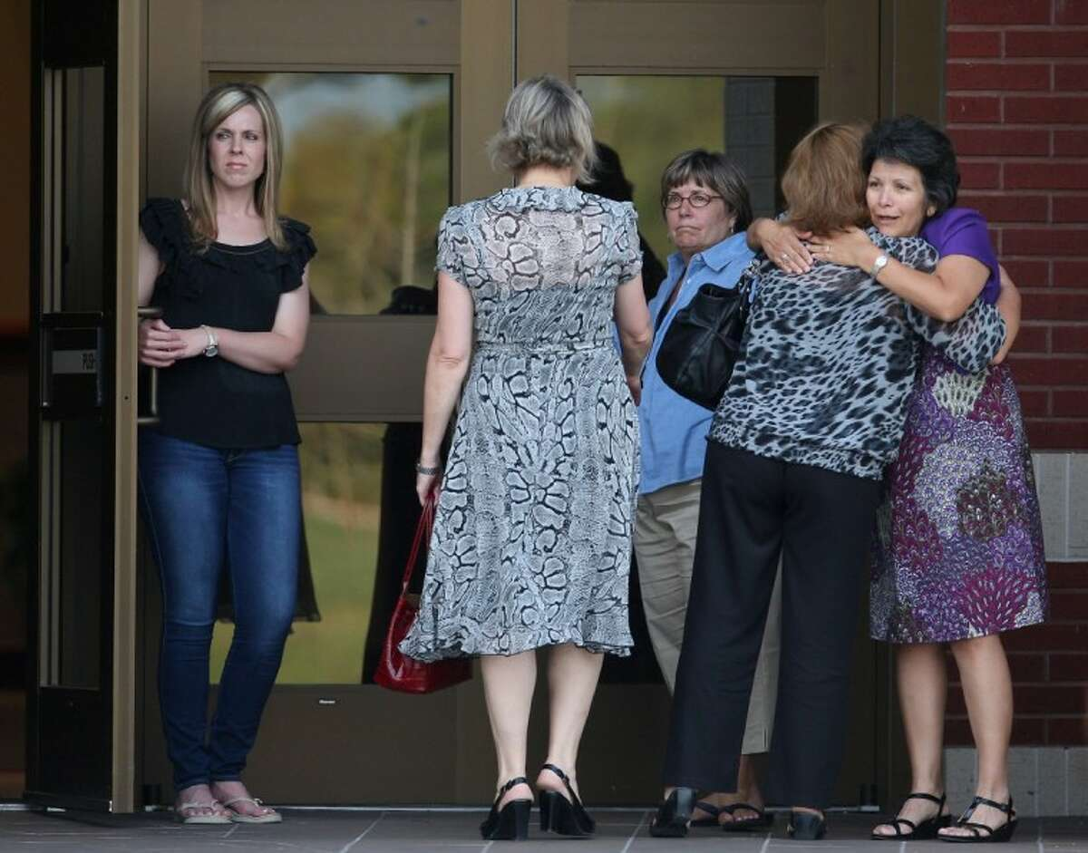 Family and friends of Constable Pct. 1 Brian Bachmann arrive at Christ United Methodist Church for a vigil Monday in College Station following a shooting that left three people dead, including Constable Bachmann near the Texas A&M campus.