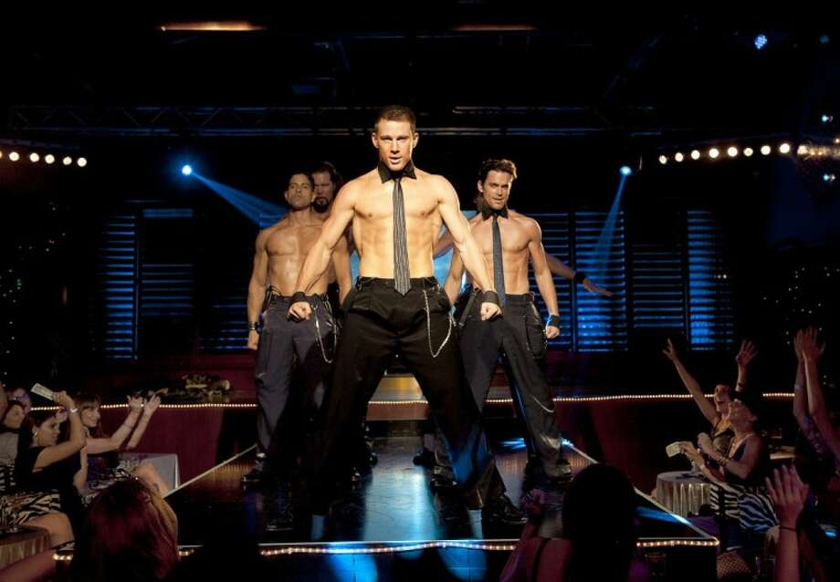 "This film image released by Warner Bros. shows, from left, Adam Rodriguez, Kevin Nash, Channing Tatum, and Matt Bomer in a scene from ""Magic Mike."" Matthew McConaughey, Channing Tatum, Alex Pettyfer, Joe Manganiello and Matt Bomer play fire men, cops and other exaggerated versions of hyper-masculine characters in the Steven Soderbergh film. Photo: Claudette Barius"
