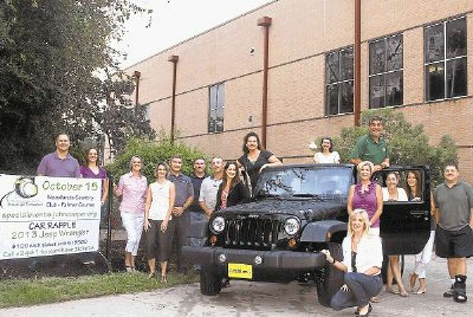 Members of the 2012 JCS Golf Tourney Committee are pictured in a Jeep Wrangler from Mac Haik: from left, David Kaczynski, Morgan Frontczak, Lyn Brus, Wendy Stearns, David Miller, Terry Taylor, Athletic Director Mike Cooper, Sue Frusco, Karen Van Buren, Carole McRobbie, Rod Pitts (chair), Nancy Wagner, Jill Harris (kneeling), Lisa Katz, Melissa Horak and Joel Bates. Committee members who are not pictured include: Dan Woodall, Iram Taylor, Polly Craddock, Rainy Chandler, Scott Heard, Sal Frusco, Todd Adam, and Tom Forestier.