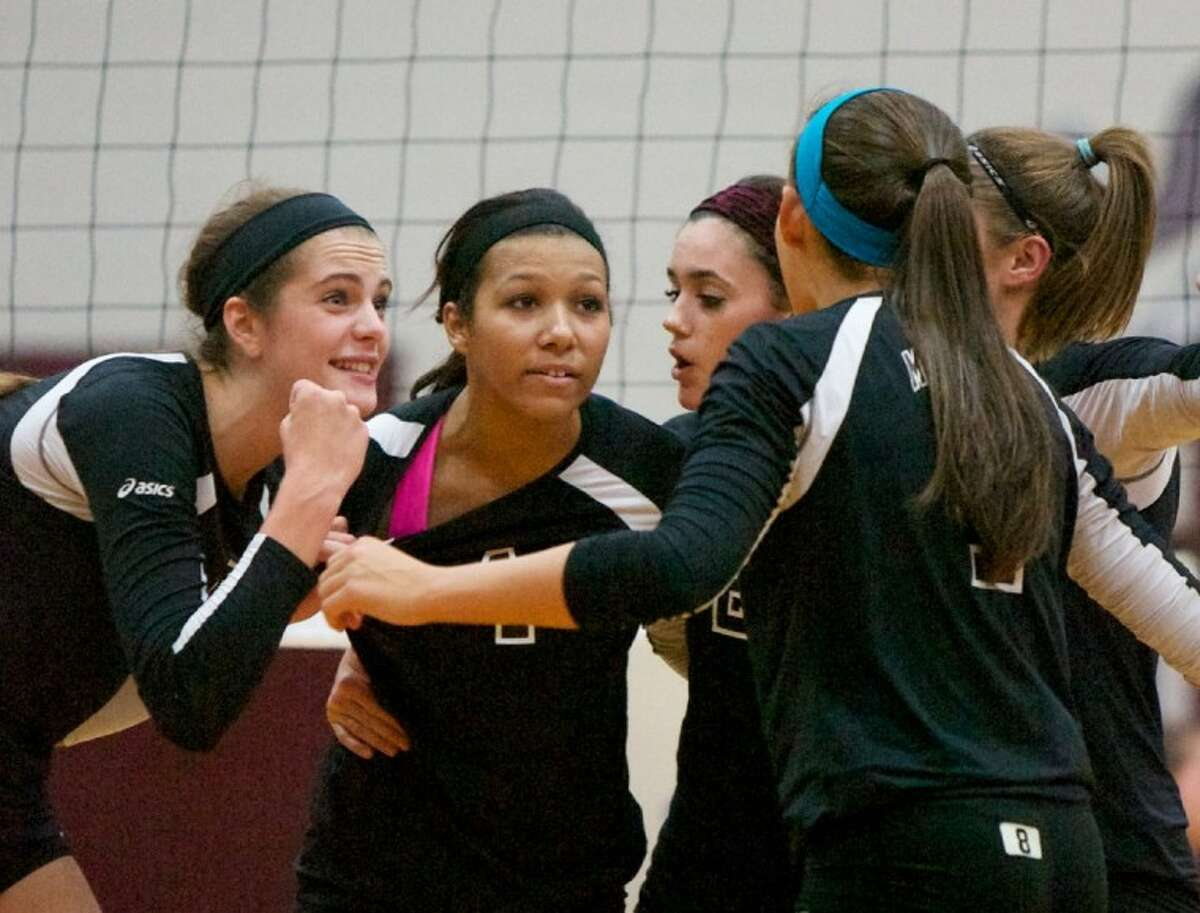 Magnolia's Kylie Randall, left, was named the MVP of the all-district team chosen by the District 18-4A coaches.