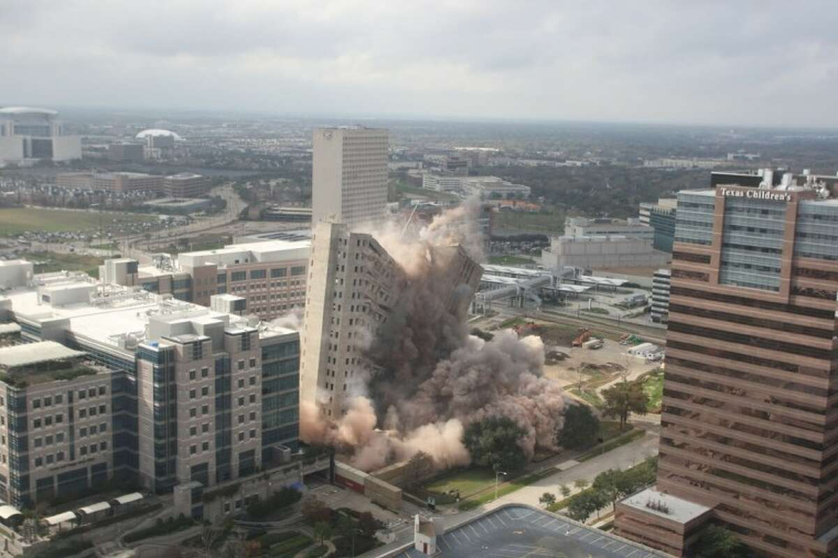 The historic Prudential Building in the Texas Medical Center sinks to the ground Sunday.