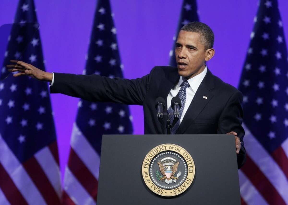 President Barack Obama gestures as he speaks at The Associated Press luncheon during the ASNE Convention Tuesday in Washington.