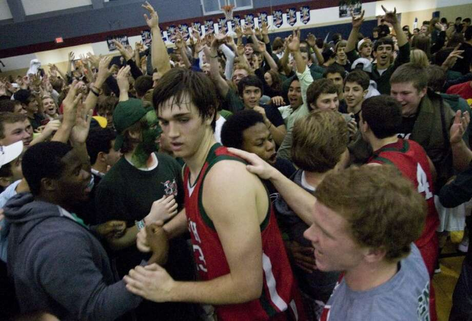 The Woodlands' Joey Trinkle is congratulated by fans after the team defeated College Park during Friday night's district game. Photo: Staff Photo By Eric S. Swist
