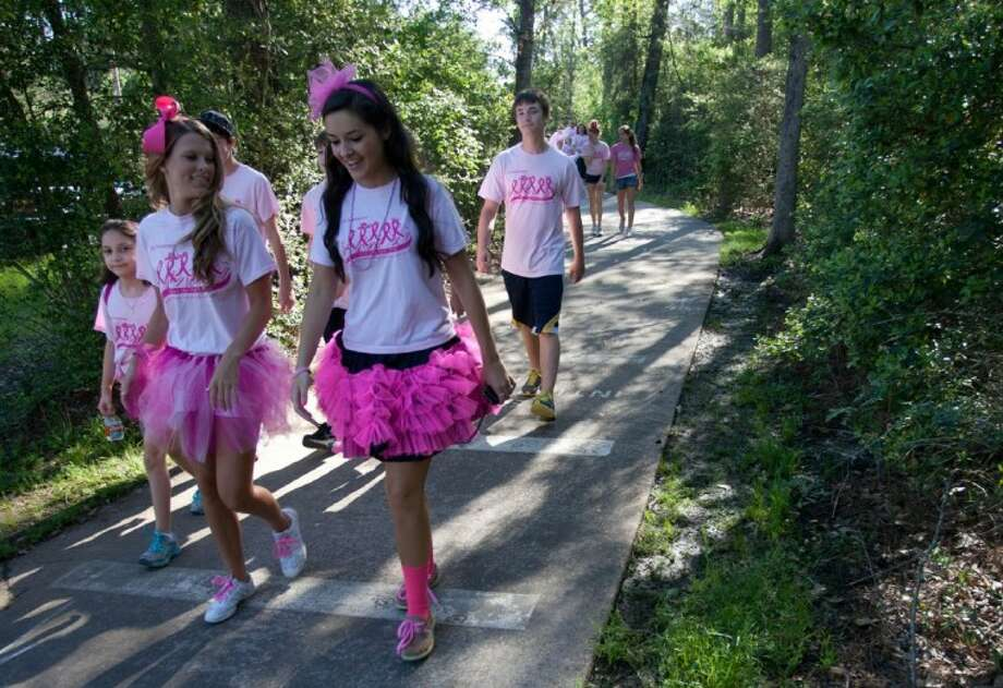 "Participants take part in the 5th annual ""Paint the Path Pink"" event, a 3-mile charity walk at Mitchell Intermediate School benefiting breast cancer research and local victims of the deadly disease on Saturday in The Woodlands. Photo: Staff Photo By Eric S. Swist"