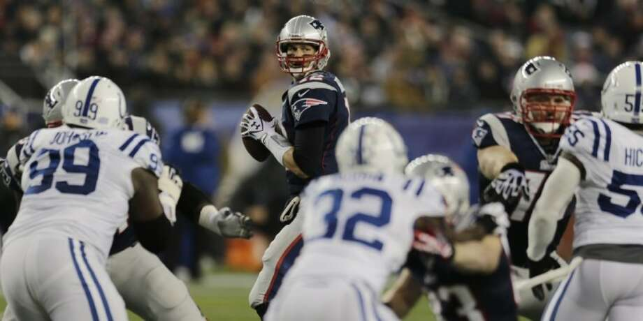 New England Patriots quarterback Tom Brady looks to pass against the Indianapolis Colts on Sunday at Gillette Stadium in Foxborough, Mass. Photo: Charles Krupa