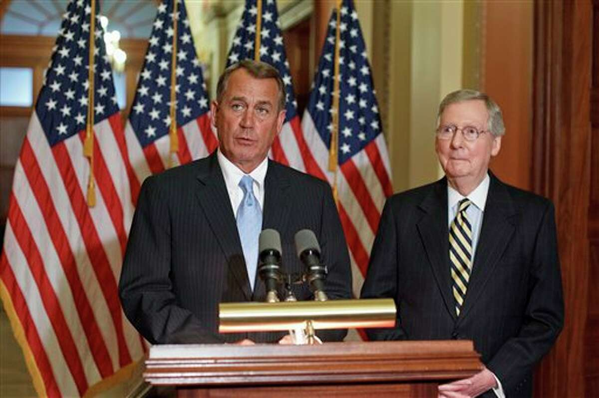 House Speaker John Boehner of Ohio, left, accompanied by Senate Minority Leader Mitch McConnell of Ky., speaks during a news conference on Capitol Hill in Washington, Wednesday, Feb. 29, 2012, to talk about their lunch meeting with President Obama to discuss rising gasoline prices. (AP Photo/J. Scott Applewhite)