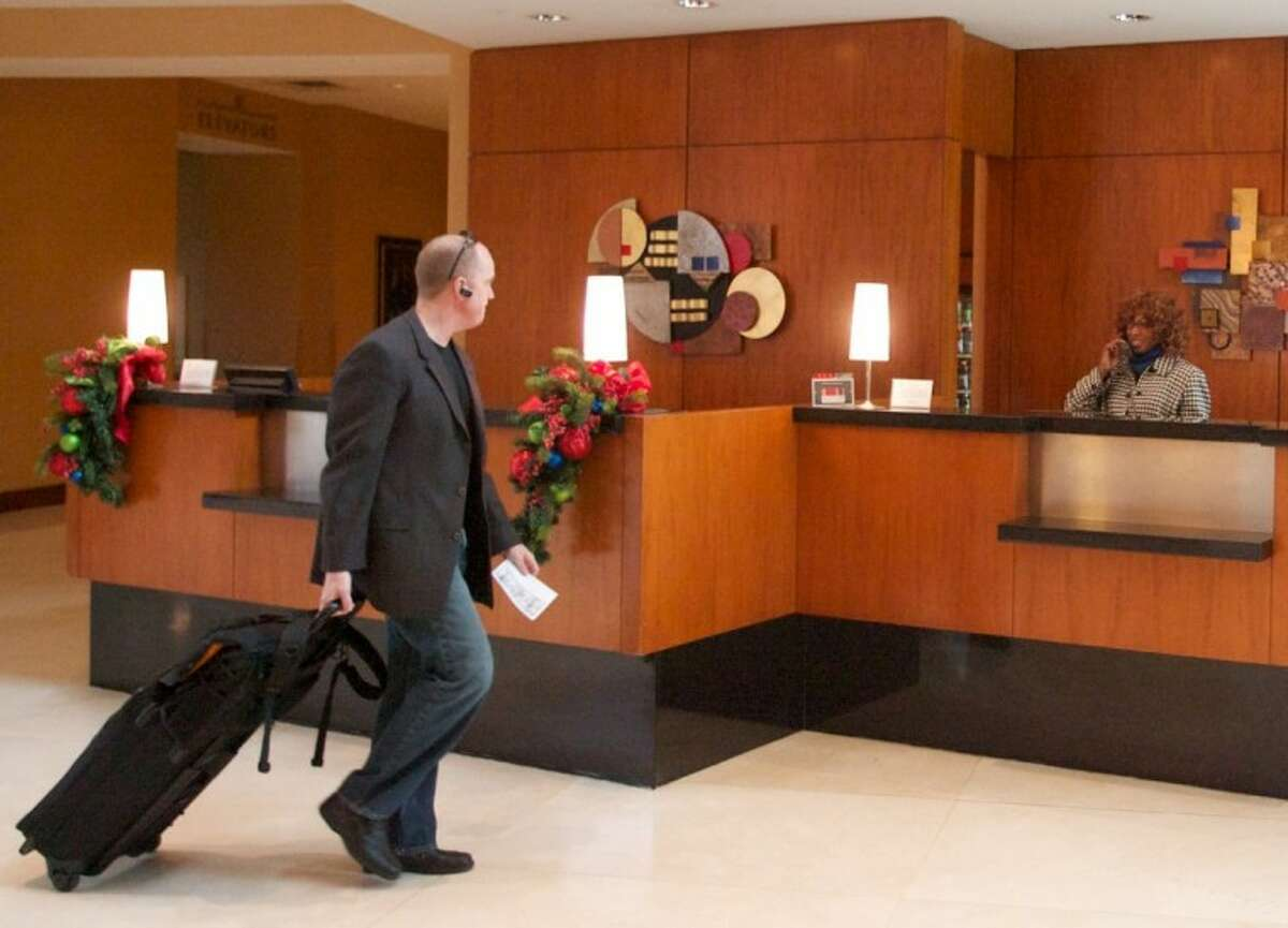 A guest prepares to check-in at the front desk of The Woodlands Waterway Marriott Hotel and Convention Center.